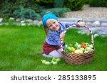 little girl with baskets full... | Shutterstock . vector #285133895