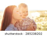 mother and her child playing in ... | Shutterstock . vector #285238202