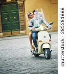 cute young couple riding... | Shutterstock . vector #285281666