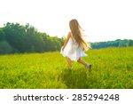 Little Girl Running On Green...