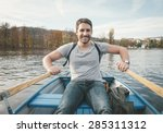 happy smiling man rowing on the ... | Shutterstock . vector #285311312