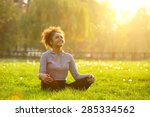 happy young woman sitting... | Shutterstock . vector #285334562