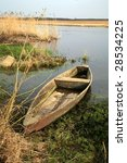 Wooden   boat on the bank - Narew National Park. Main Narew river divides into several smaller rivers, which further connects to the in one river again. The only effect of this type in Europe. Poland. - stock photo