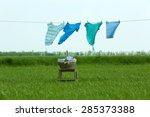 Stock photo laundry line with clothes in field 285373388