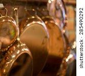 copper kitchenware in bokeh.... | Shutterstock . vector #285490292