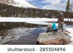 the child pulls a fish from...   Shutterstock . vector #285504896