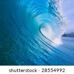 Large Blue Surfing Wave Breaks...
