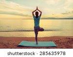 Young Woman Doing Yoga Exercise ...