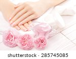 french manicure with rose...   Shutterstock . vector #285745085