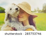 young woman and her dog | Shutterstock . vector #285753746