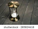 hourglass on wooden background | Shutterstock . vector #285824618