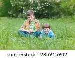 two brothers sitting in green...   Shutterstock . vector #285915902