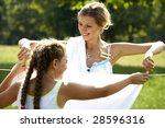 Stock photo funny mom and daughter hanging clothes on the line outdoors 28596316