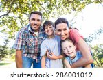 happy family in the park... | Shutterstock . vector #286001012