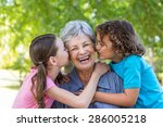 extended family smiling and... | Shutterstock . vector #286005218