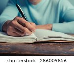 a young man is sitting at a... | Shutterstock . vector #286009856