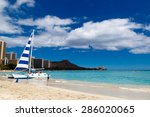 boat and people on waikiki beach | Shutterstock . vector #286020065