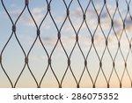 metal mesh wire fence defocus... | Shutterstock . vector #286075352