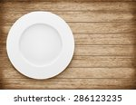empty plate on wooden table.... | Shutterstock .eps vector #286123235
