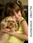 a young girl loving on her puppy | Shutterstock . vector #2861756