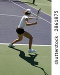 woman playing tennis at the... | Shutterstock . vector #2861875