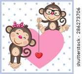 Two Monkeys On A Background Of...