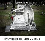 Weeping Angel With Red Flowers