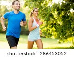 young couple running | Shutterstock . vector #286453052
