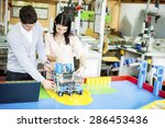 young people in the robotics... | Shutterstock . vector #286453436