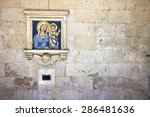 "Small photo of Old charity box embedded in a stone wall. On the wall you can see the inscription: ""La limosina pi poveri prigioni"" which means ""The alms for the poor prisoners""."