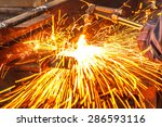 sparks while cutting steel in... | Shutterstock . vector #286593116