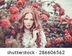 Stock photo portrait of young woman in the spring time almond flowers blossoms girl dressed in white like a 286606562