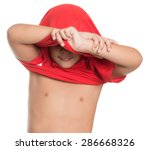 small boy taking off his tshirt ... | Shutterstock . vector #286668326