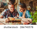 happy couple sitting in cafe... | Shutterstock . vector #286740578