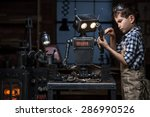 young boy mechanic repairing... | Shutterstock . vector #286990526
