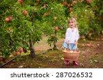 cute little girl picking apples ... | Shutterstock . vector #287026532