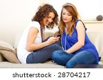 casual friends on a couch using ... | Shutterstock . vector #28704217