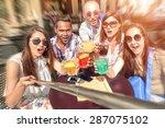 best friends using selfie stick ... | Shutterstock . vector #287075102