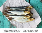 Oily Fish Is Smoked On Paper
