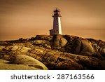 Lighthouse On A Rocky Shore