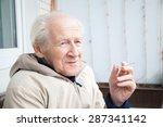 Smiling Old Man Enjoying A...