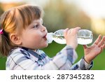 girl drinking water. portrait... | Shutterstock . vector #287345282