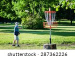 Man Playing Disc Golf In A Par...