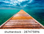 Empty Wooden Dock Over Tropica...