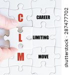 Small photo of Hand of a business man completing the puzzle with the last missing piece.Concept image of Business Acronym CLM as Career Limiting Move