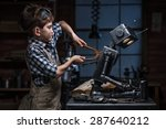 young boy mechanic repairing... | Shutterstock . vector #287640212