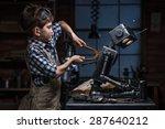 young boy mechanic repairing... | Shutterstock . vector #287640212