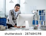 smiling indian programmer at... | Shutterstock . vector #287684198