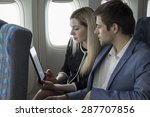 2 passengers on a plane looking ... | Shutterstock . vector #287707856