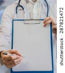 doctor holds clipboard with... | Shutterstock . vector #287821472